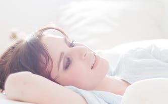 image of woman laying on adjustable air mattress