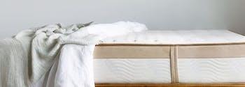 saatva sheets on top of saatva mattress inside bedroom