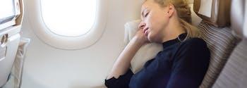 image of woman sleeping on plane