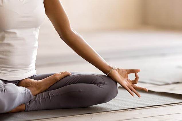 image of woman doing yoga stretch