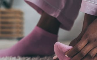 image of person touch foot in socks