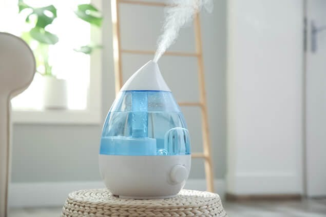humidifier on table, which can help relieve a stuffy nose at night