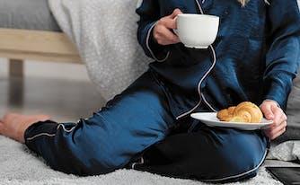 best pajamas - image of woman in dark blue pajamas