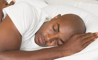 image of man sleeping - how to break in a latex mattress