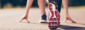 exercise for sleep - image of woman's sneakers getting ready to run