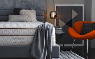 saatva mattress in bedroom with light fixture next to it