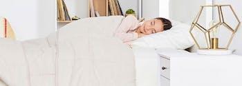 child sleeping in saatva youth mattress