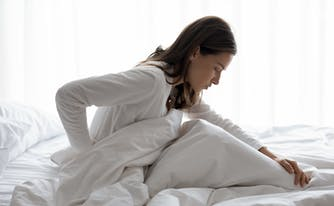 best mattress for scoliosis - person with scoliosis in bed