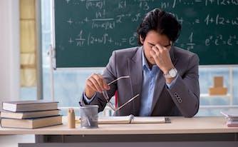 teacher tired at desk