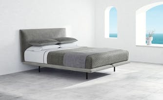 image of saatva mattress on mattress foundation