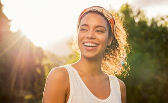 image of person smiling in sunshine