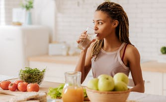 person drinking water as part of morning routine
