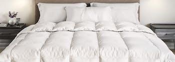saatva down alternative comforter on top of bed