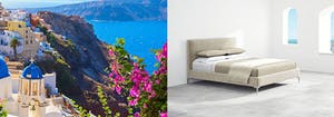 white buildings with blue domes on Santorini coastline, next to Saatva's Santorini platform bed frame