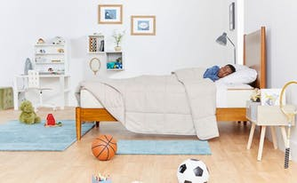 twin bed dimensions - child sleeping in twin size bed