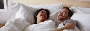 queen size bed dimensions - couple lying in queen size bed