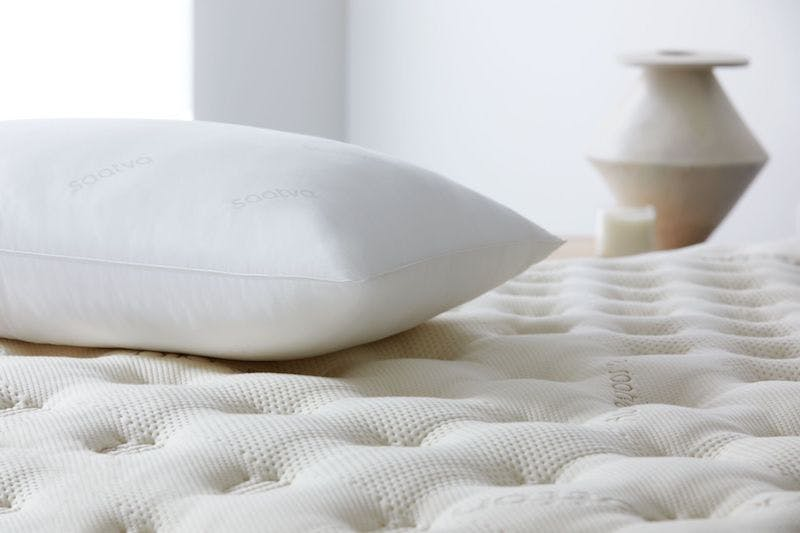 saatva down alternative pillow on top of mattress