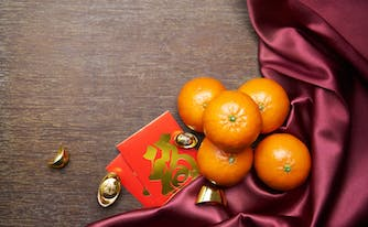 oranges, red envelopes, and gold coins for chinese new year