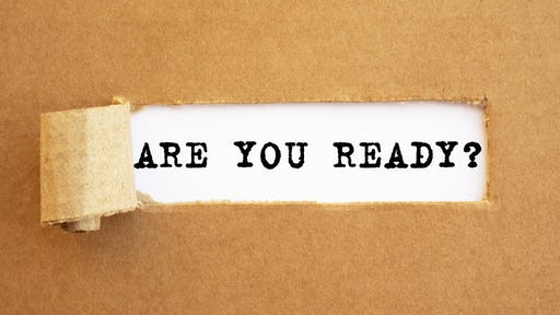 text, are you ready? appearing in torn brown paper