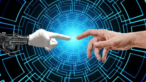 A robot hand touching with its finger a human finger