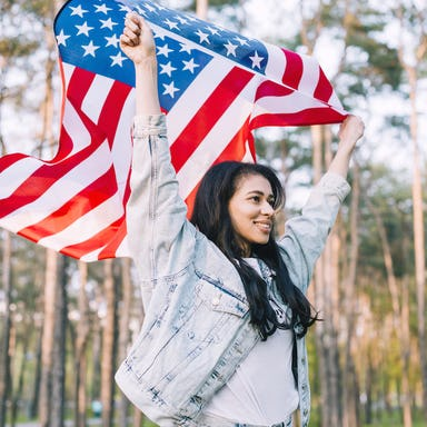 Girl waving a United States flag