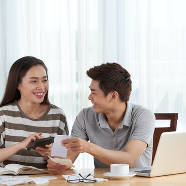 Young couple managing their budget at home