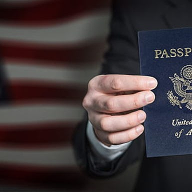 Person holding and showing a United States passport