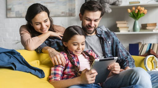 Happy family looking on a tablet