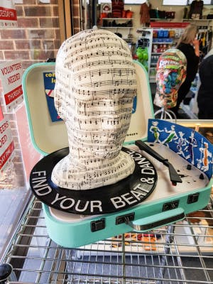 > Repurposed record player and music pieces make a quirky display for the store