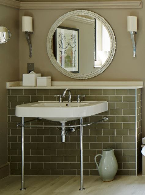 Samuel Heath traditional Fairfield brass tap in a chrome finish. Mounted on vanity unit with green tiles.