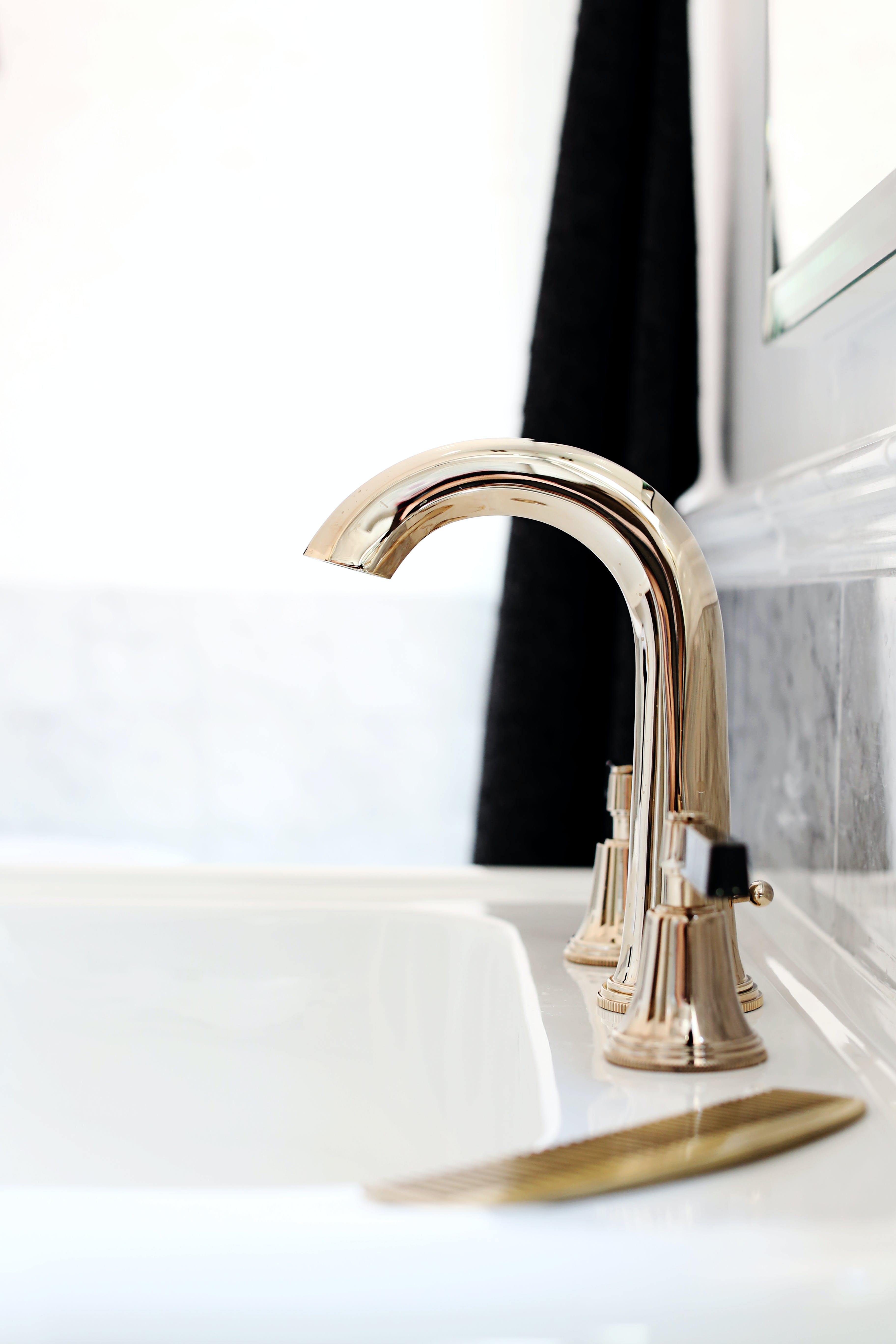 Luxury Art Deco taps mounted on a white basin