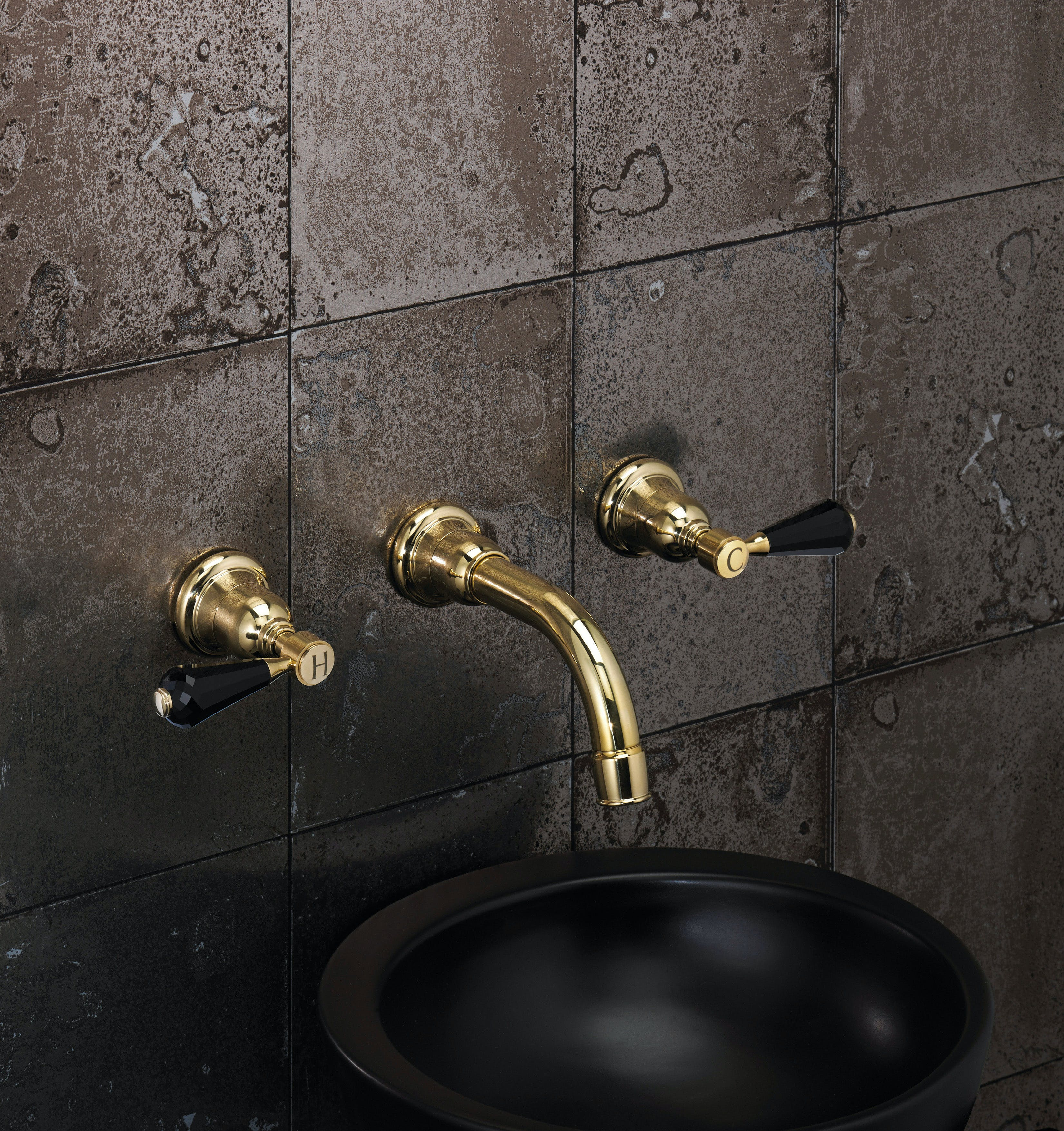 Samuel Heath wall mounted unlacquered brass tap. Traditional Fairfield collection with black crystal levers.