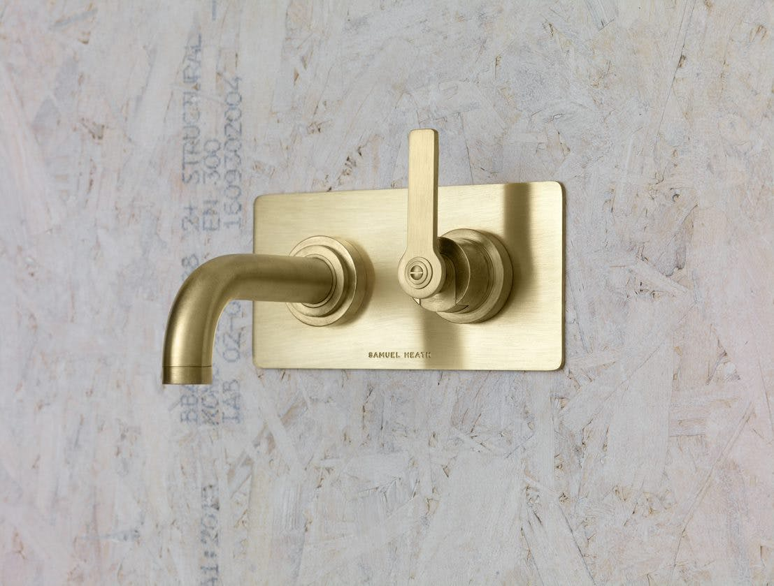 Samuel Heath Landmark Pure Bauhaus inspired wall mounted single lever tap in a natural urban brass finish which will patina.