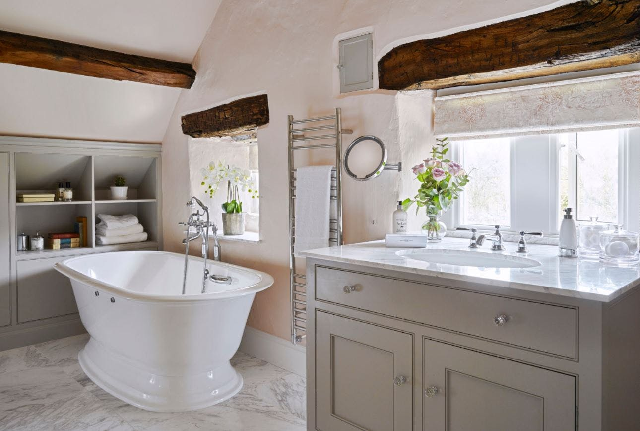 Samuel Heath Fairfield traditional brassware within a cottage interior. Chrome finish taps and bath filler.