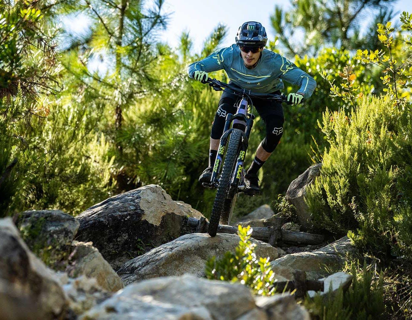 Loris Vergier riding through rocks