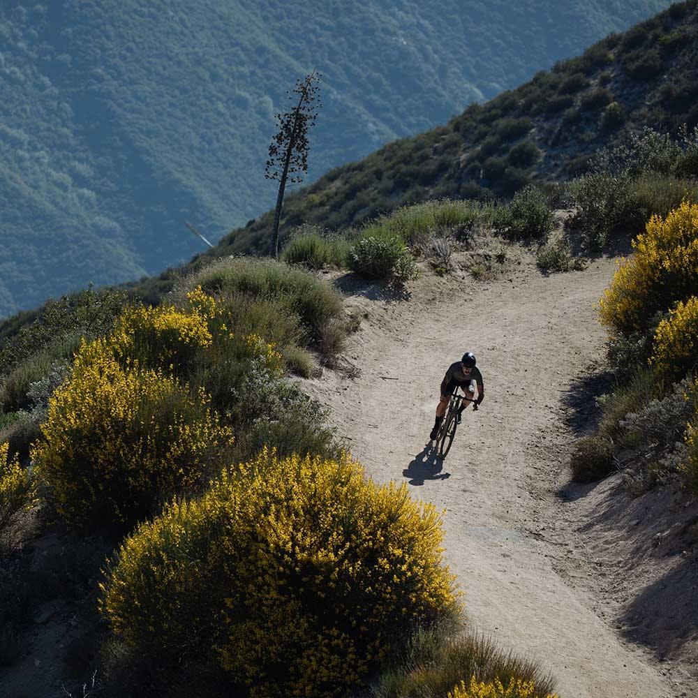 Gravel rider on desert road