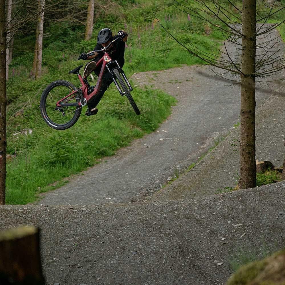 Mountain biker whipping 5010 at bike park