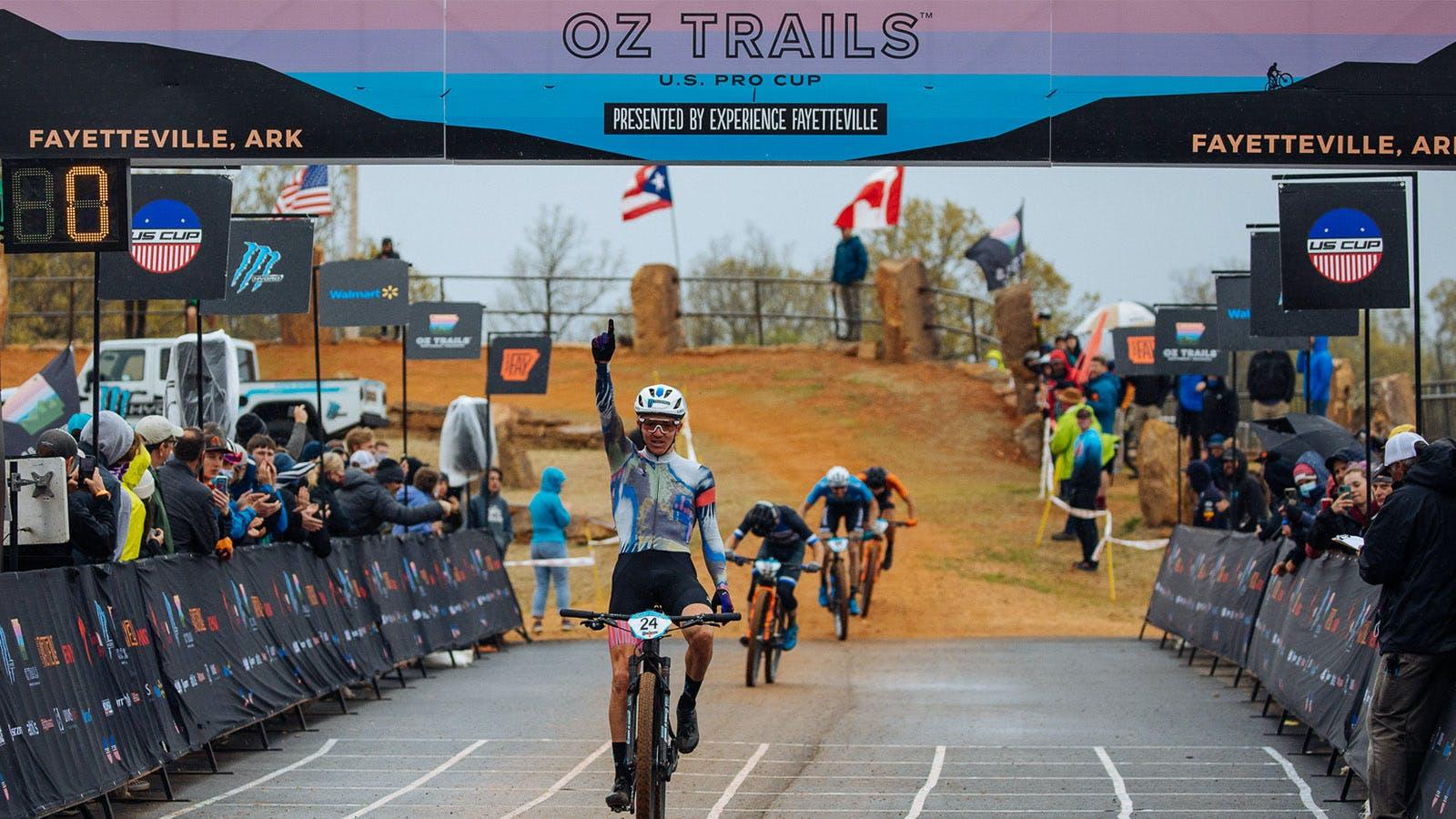 Keegan Swenson reaching the finish line in Fayetteville, Arkansas