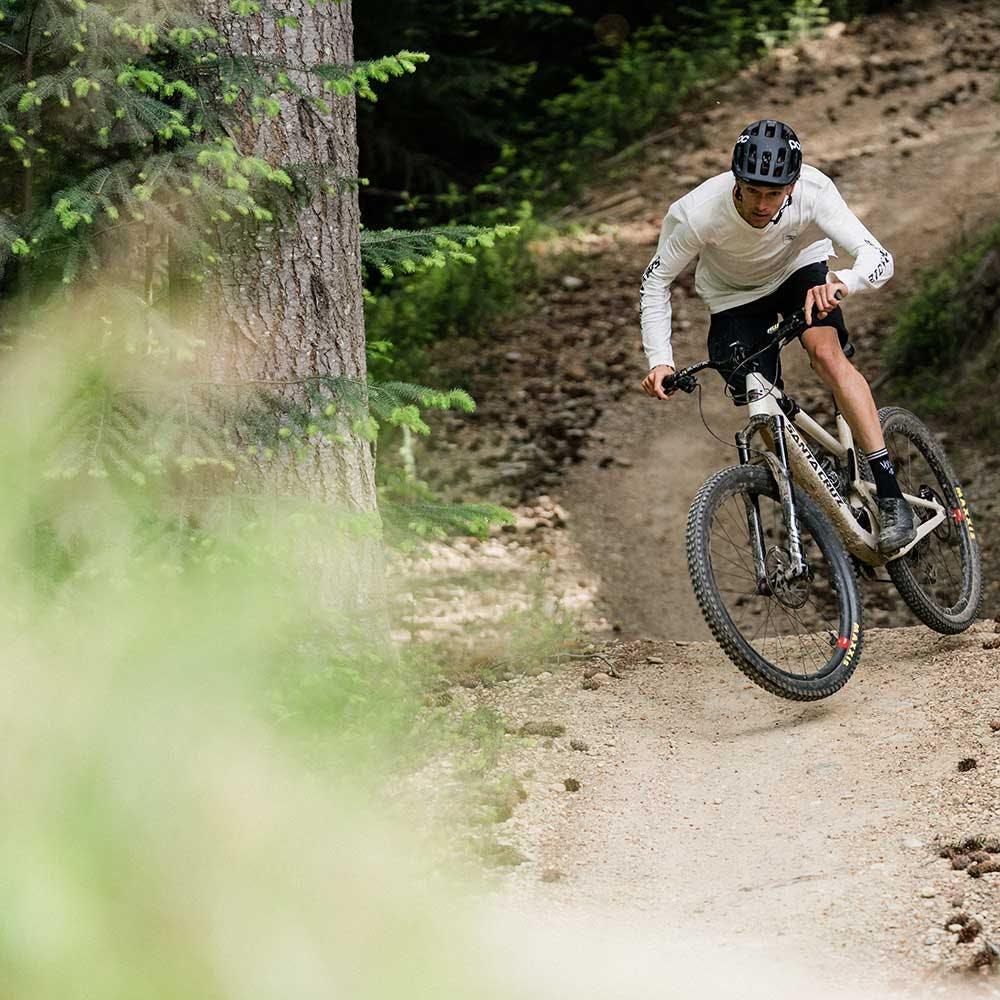 Mountain biker in white shirt on Tallboy