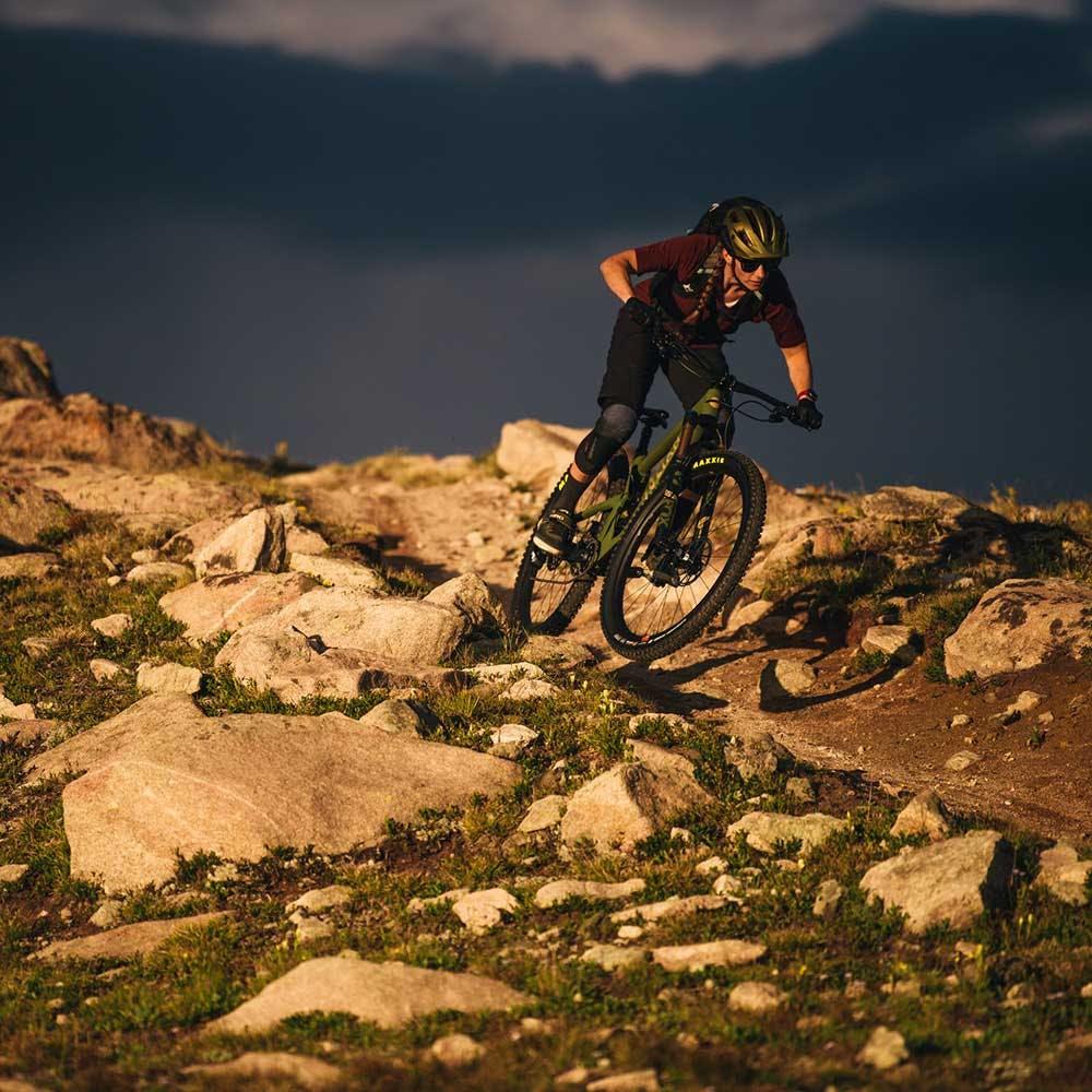 Riding the 2021 Maverick over a rocky trail