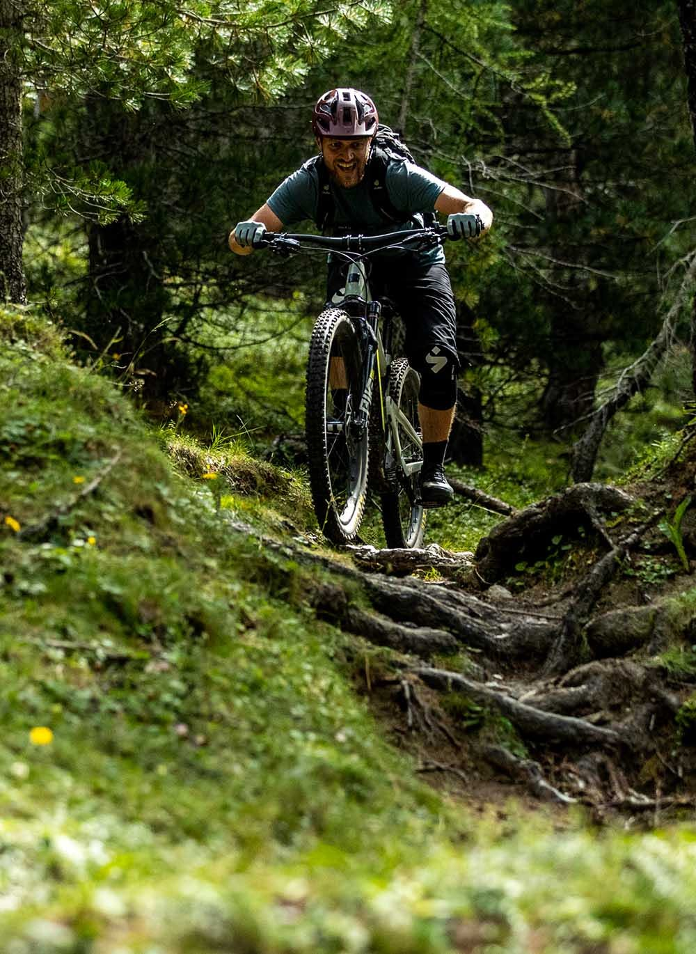 Ash Smith riding roots on his Heckler MX ebike
