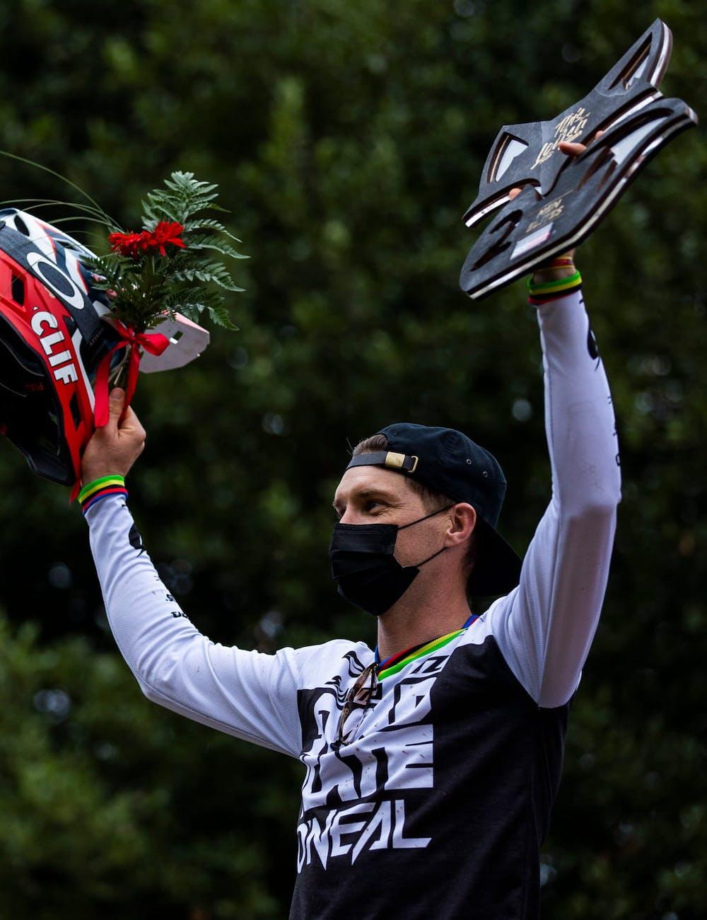 Greg Minnaar celebrating a World Cup DH win