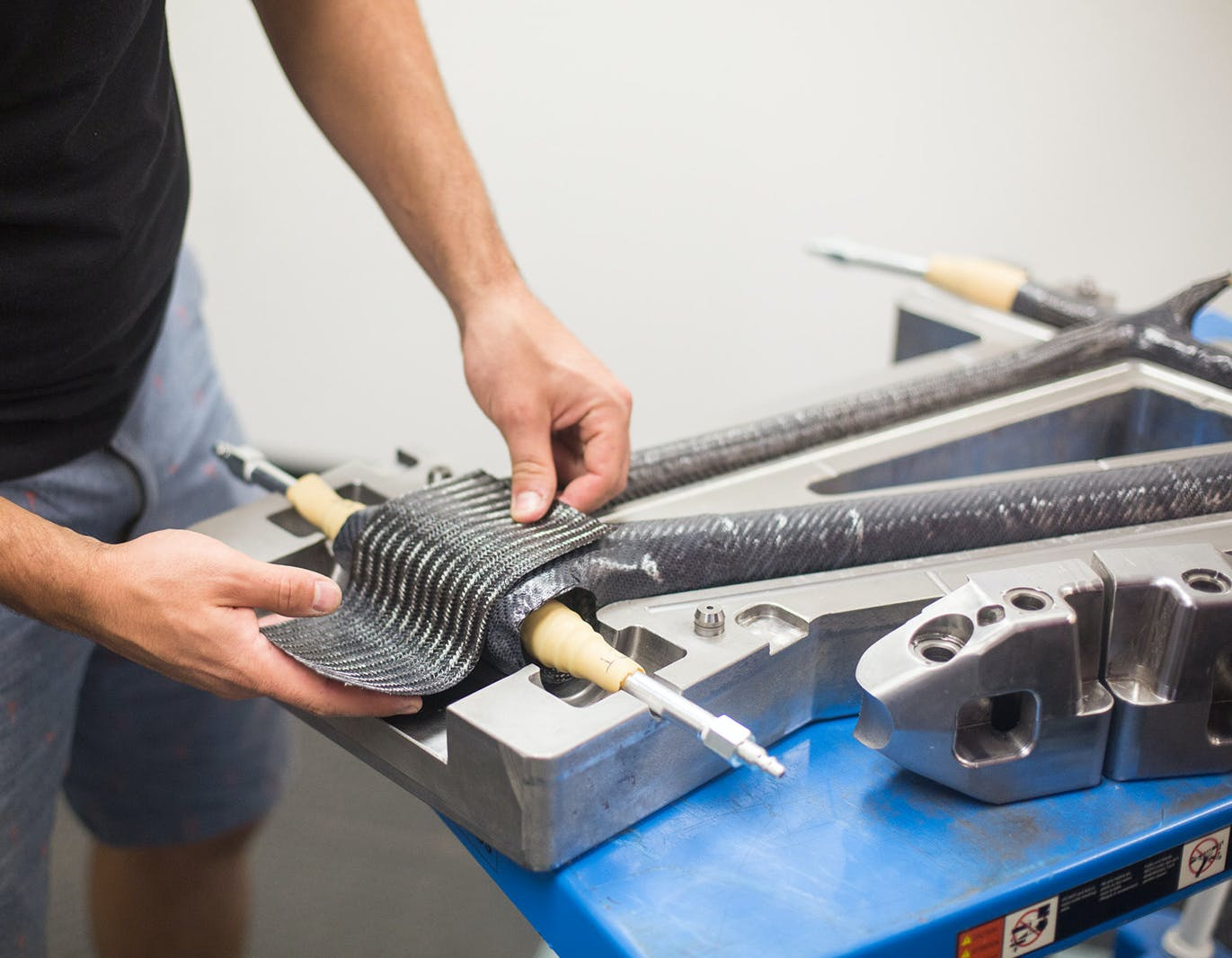 Wrapping carbon fiber onto a frame