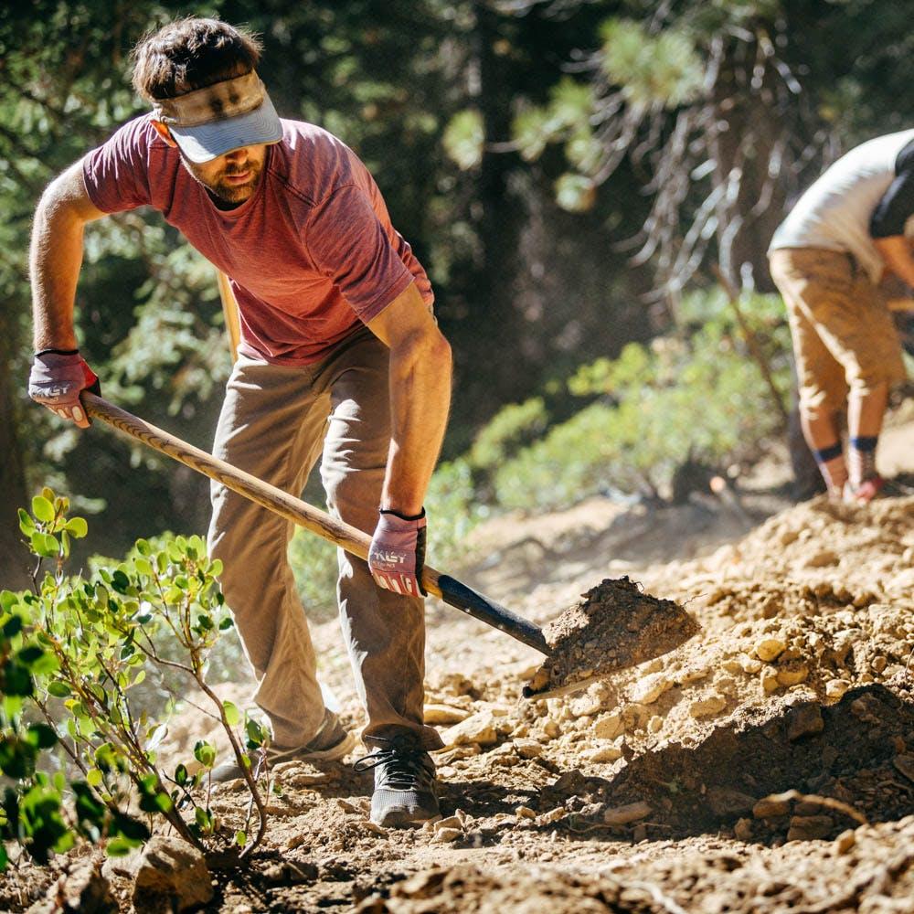Sierra Buttes Trail Stewardship (SBTS) trail crew shoveling in the Sierra-Nevada Mountains