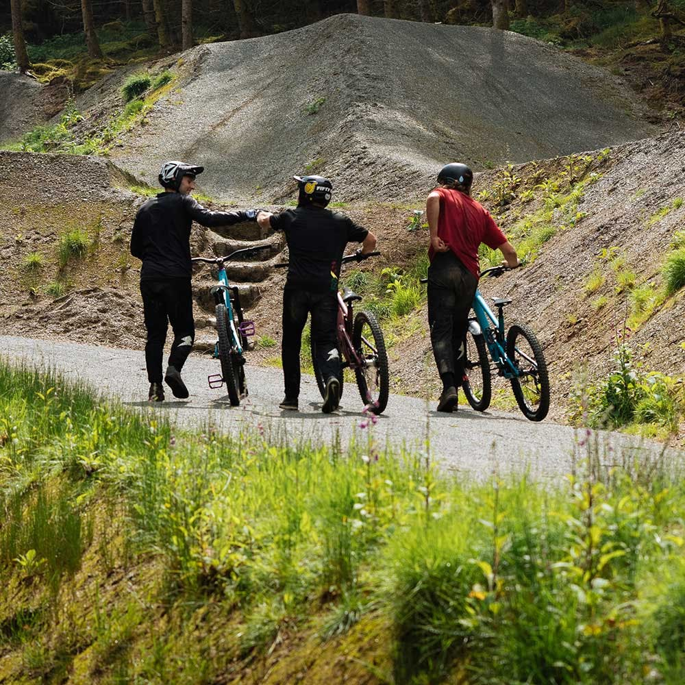 Three mountain bikers with 5010s