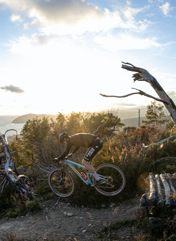 Luca Braidot hitting a jump on his Blur mountain bike