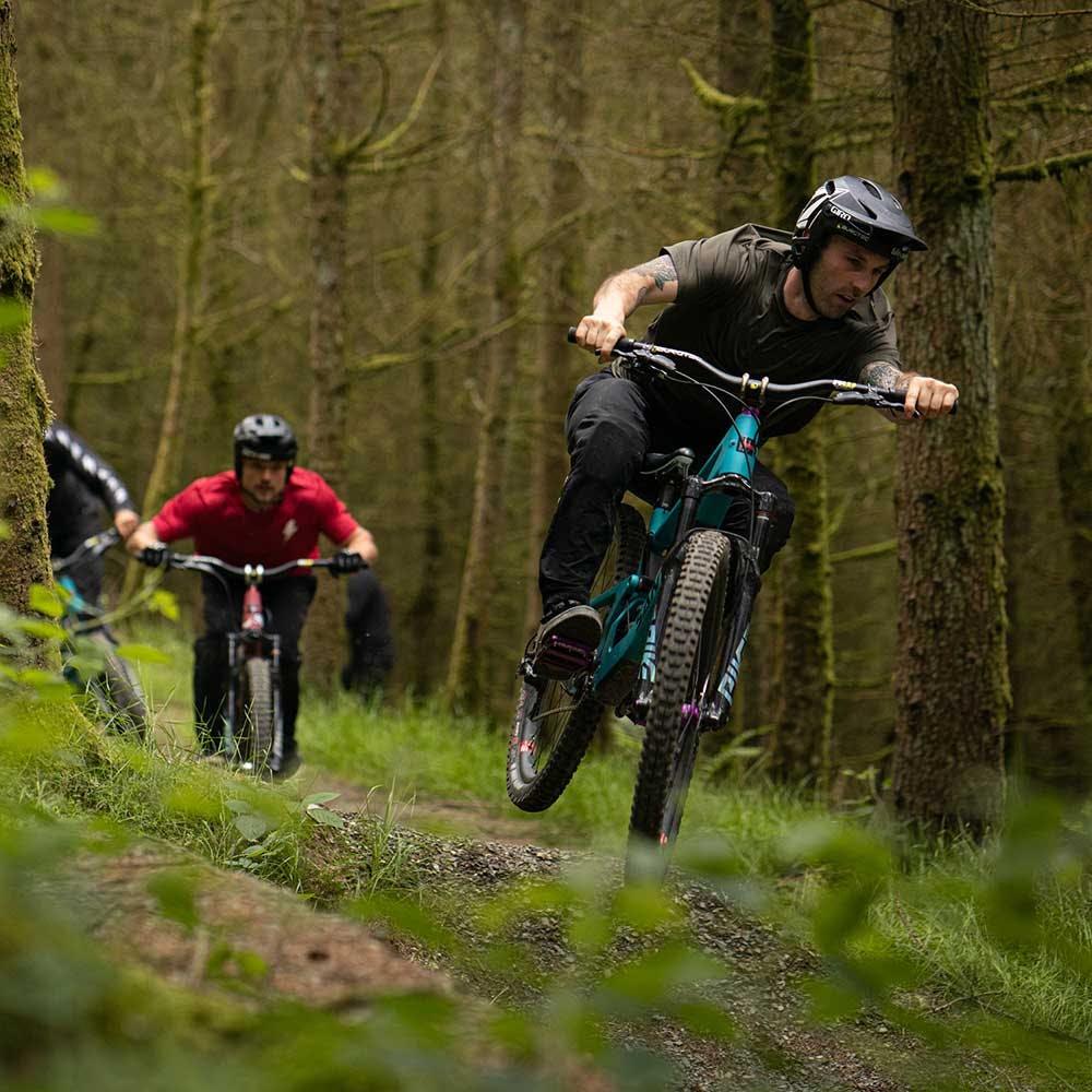 Mountain biker riding 5010 in woods