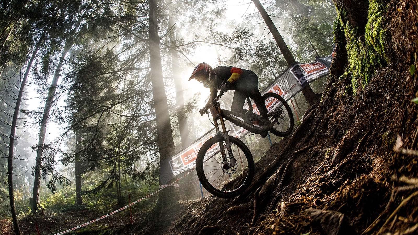 Nina Hoffman racing her downhill bike