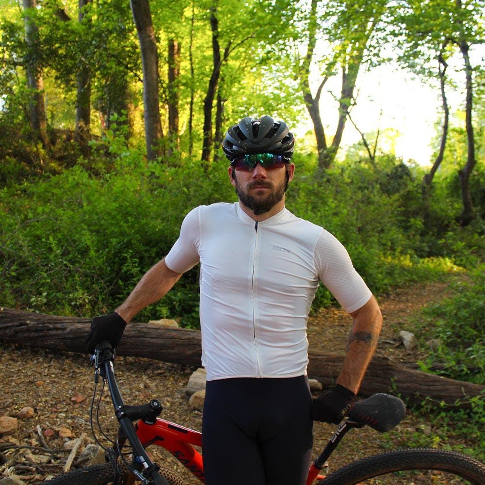 Andrew Dahlheim leaning on his bike