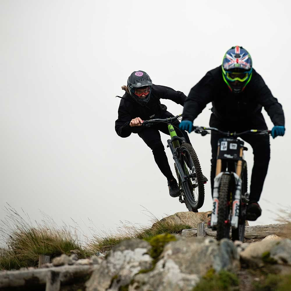 Two mountain bikers riding Nomads in fog